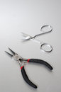 Pliers and scissors on the gray background Royalty Free Stock Photo