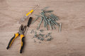Pliers, screwdrivers and different size screws lay on table Royalty Free Stock Photo