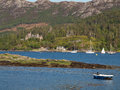 Plockton scotland highlands view of s duncraig castle in the pine forest covered mountains and boats on loch carron in the Stock Photos