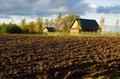 Ploughed field and house Royalty Free Stock Photo