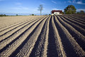 Ploughed field and house Royalty Free Stock Photos