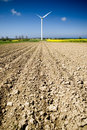 Ploughed field wind turbine Royalty Free Stock Images