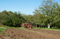 Plow in field tractor and close up Stock Photos