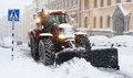Plow removing snow from city street in Stockholm