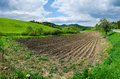 Plowed agricultural field. Tillage field et farm in sunny day. Royalty Free Stock Photo