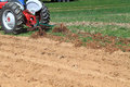 Plowing farmland for planting farmer working in field in to prepare planing on his tractor Stock Photos
