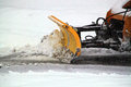 Plowing snow during winter storm Royalty Free Stock Photos