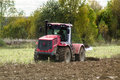 Plowing tractor is an important element of agricultural work ploughing or tillage otvorenim plow when Royalty Free Stock Photo