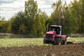 Plowing tractor is an important element of agricultural work ploughing or tillage otvorenim plow when Stock Photos