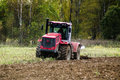 Plowing tractor is an important element of agricultural work ploughing or tillage otvorenim plow when Stock Photo