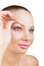 Plucking eyebrows Stock Photo