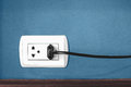 Plug on blue wall electrical Royalty Free Stock Photo