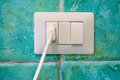 Plug in a wall socket white with turquoise majolica Royalty Free Stock Photography