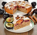Plum cake on a brown table Royalty Free Stock Photo