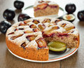 Plum cake on a brown table Stock Image