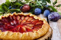 Plum cake on a wooden surface Royalty Free Stock Photo