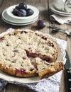 Plum crumb tart on wooden table Stock Photo