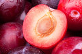 Plum cut half macro closeup Royalty Free Stock Photos