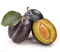 Plum and a half and leaves Royalty Free Stock Photo