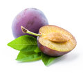 Plum and a half with leaves Royalty Free Stock Photo