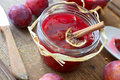 Plum jam fresh in a glass with cinnamon Stock Photos