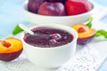 Plum jam and fresh plums Royalty Free Stock Photo