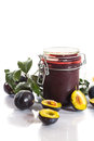 Plum jam with fresh plums on a white background Royalty Free Stock Photo