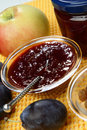 Plum jam and raisins in glass bowl Stock Photography