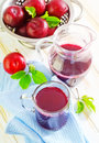 Plum juice in glass jug Royalty Free Stock Images