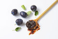 Plum preserve on wooden spoon Stock Photography