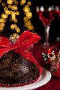 Plum pudding and christmas tree Royalty Free Stock Images