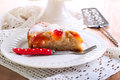 Plum sponge cake with icing sugar on top Royalty Free Stock Images