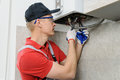 Plumber attaches to pipe gas boiler. Royalty Free Stock Photo