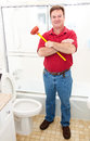 Plumber in bathroom or homeowner holding a plunger and standing a modern Stock Images