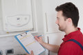 Plumber control check on the home water boiler Royalty Free Stock Photo