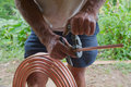 Plumber Cutting copper pipe Royalty Free Stock Photo
