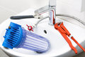 Plumber equipment and water filter in the sink Royalty Free Stock Photo