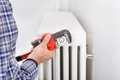 Plumber fixing radiator close up of male with wrench Stock Photography
