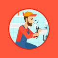 Plumber fixing sink pipe with wrench.