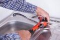 Plumber fixing washbasin Royalty Free Stock Photo