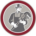 Plumber Holding Giant Wrench Woodcut Circle Royalty Free Stock Photo