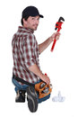 Plumber holding a pipe wrench Royalty Free Stock Images