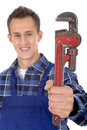Plumber holding pipe wrench Royalty Free Stock Photo