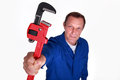 Plumber holding wrench a red Stock Photos