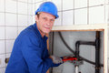 Plumber installing pipes Royalty Free Stock Photo