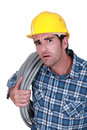 Plumber looking stunned at the job he need to complete Stock Photo