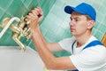 Plumber man repair leaky faucet tap Royalty Free Stock Photo