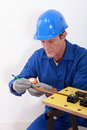 Plumber measuring copper pipe Royalty Free Stock Photo