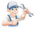 Plumber or mechanic pointing a engineer in overalls and holding a spanner wrench Royalty Free Stock Image