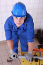 Plumber preparing pipe to cut piece of Royalty Free Stock Photo